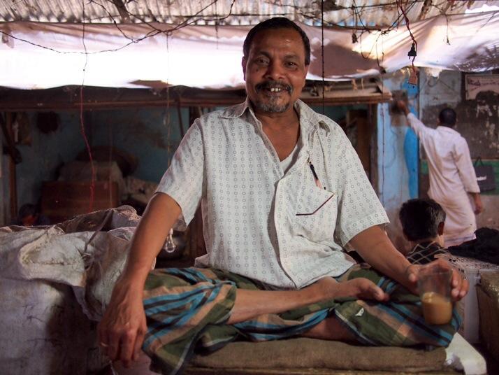 Fishmonger having a tea break, Dinajpur