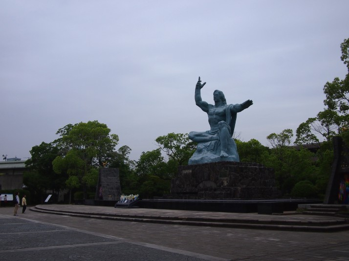 The Peace Statue at the Nagasaki Peace Park. The right hand pointing to the sky symbolises the threat of nuclear weapons, the flat left hand represents eternal peace and the eyes are closed in prayer for the souls of the victims