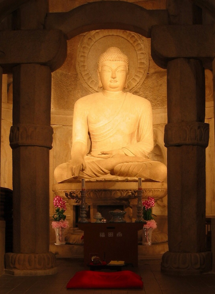 "Seokgamoni Buddha statue inside the Seokguram Grotto (Photo source: <a href=""http://commons.wikimedia.org/wiki/File:Seokguram_Buddha.JPG#mediaviewer/File:Seokguram_Buddha.JPG"" title=""""Seokguram Buddha"" by Richardfabi - Wikipedia"">Wikipedia</a>)"