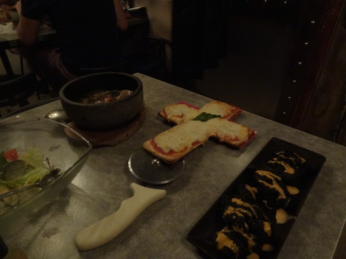 Our food at The Lockup in Shibuya (left to right): Friday the 13th Salad (because it has 13 ingredients); Firebowl Beef which the waiter set on fire!; Crucifix-shaped Pizza; and their signature Charcoal Chicken