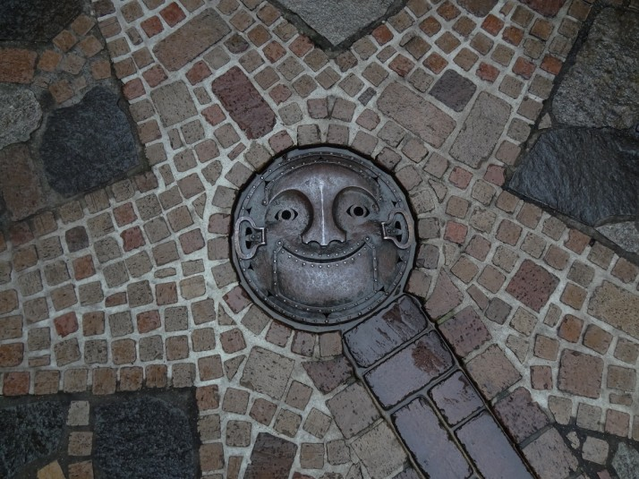 I also loved the attention to detail, like the face in this manhole cover in the courtyard