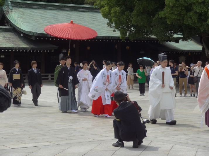 A wedding party parade through the main square of the Meiji Jingu Shrine in Harajuku