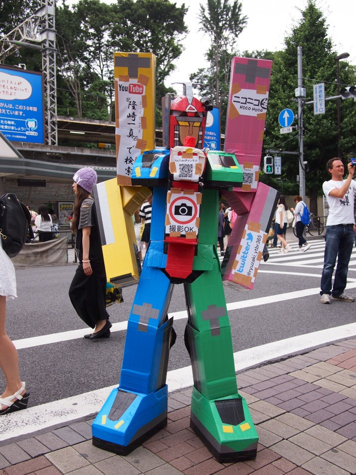 Aside from the Japanese youth culture and fashion, there were a lot of street stalls advertising shows - which is what we assumed this guy dressed as a robot was doing!