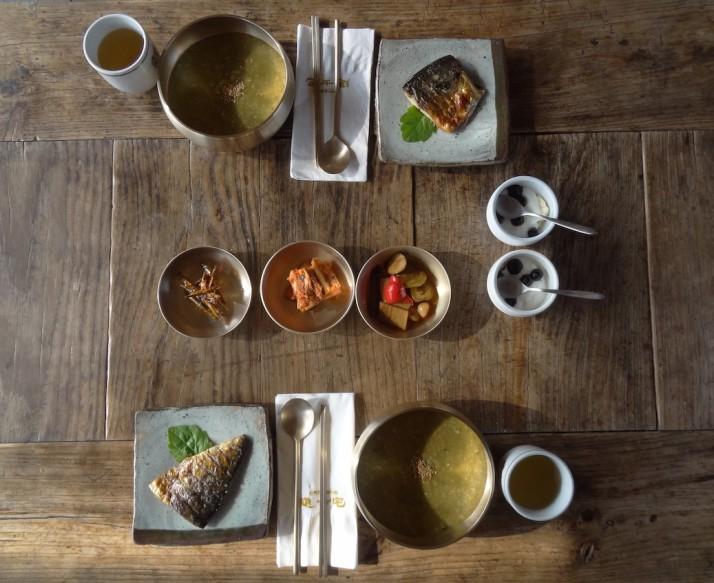 Our breakfast at the Rak-ko-jae guest house: abalone porridge; fried fish; assorted pickles; banana, yoghurt and blueberries