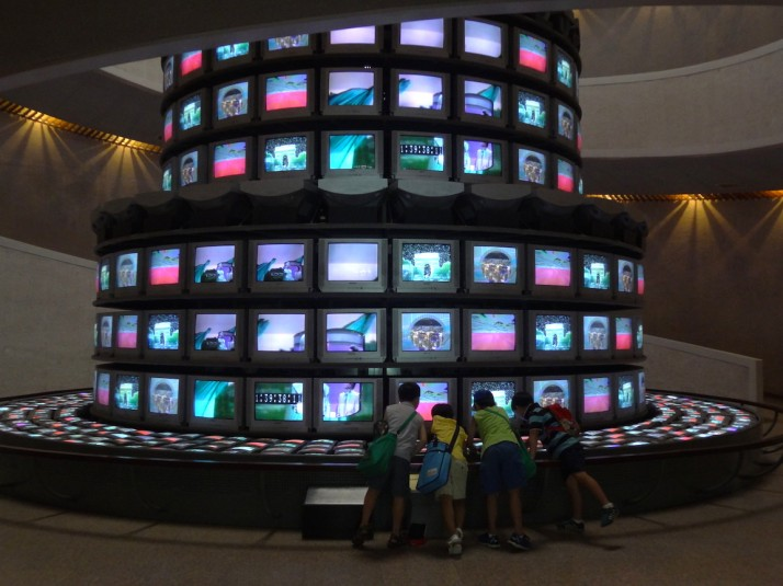 "Kids enjoying the centrepiece of the museum - ""The More, the Better"" by Dadaikseon, 1988 - produced in celebration of the Seoul Summer Olympics of the same year. It reminded us of the ""Tower of Babel"" we saw in Helsinki"
