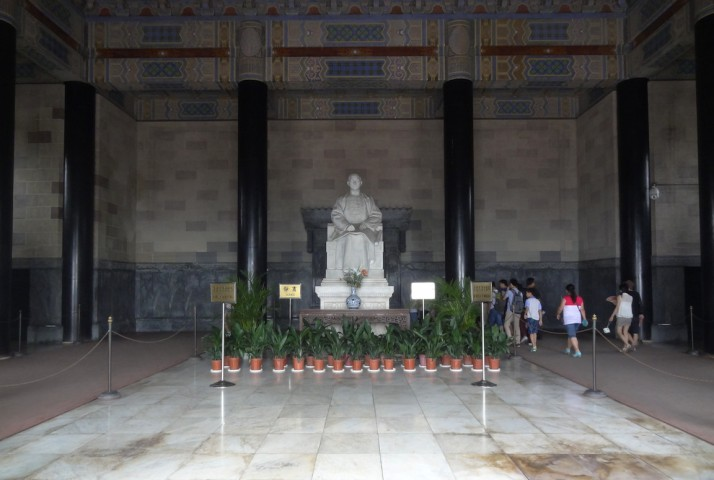 The Italian marble statue of Dr Sun Yat-sen sits in the Sacrificial Hall at the top of the mountainside stairway. His sarcophagus lies in a hall behind the statue