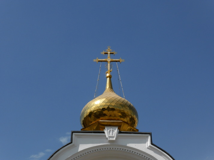 The golden domes are topped with very ornate crosses