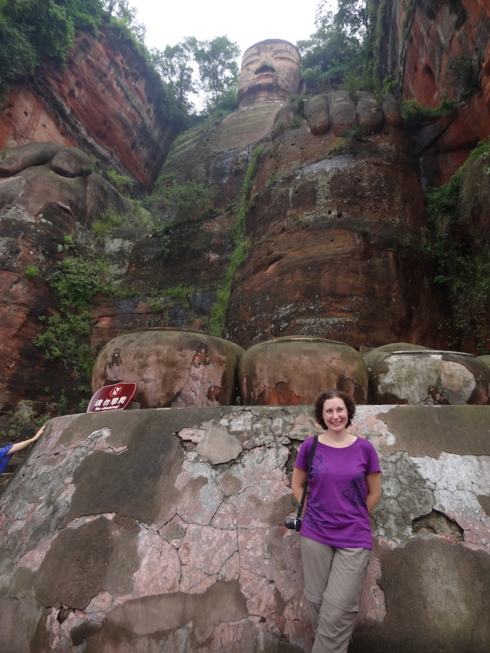 Julie at the foot of the massive Leshan Buddha statue
