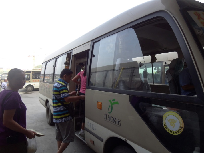 Boarding the bus from Zhangjiajie bus station to the National Park entrance