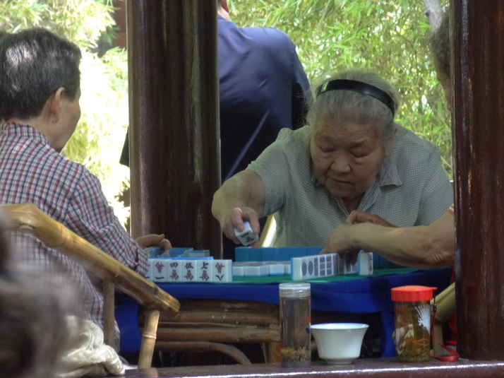 Locals playing Mahjong in one of the tea houses in The People's Park, Chengdu, China