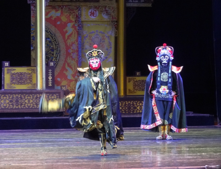 Bian Lian performers in the middle of their piece