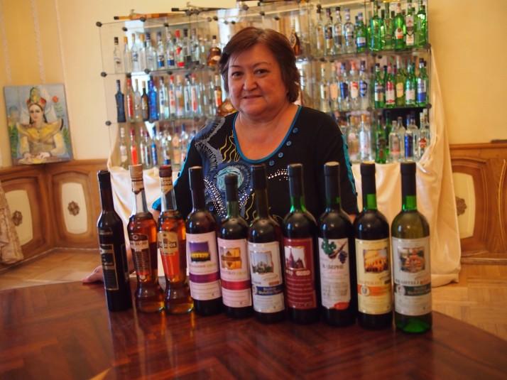 Wine tasting host with bottles