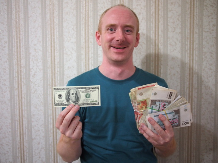 $100 US Dollars exchanged  on the black market to 300,000 Uzbek Som!