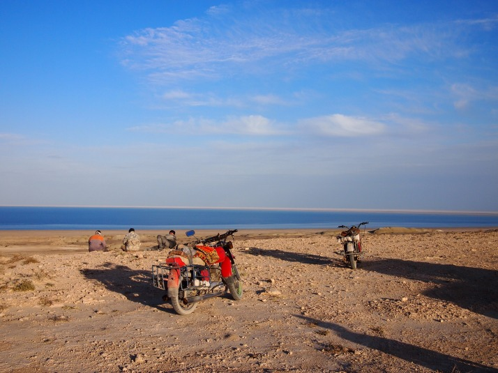 Local men rest on the cliff above the Aral Sea's western shore
