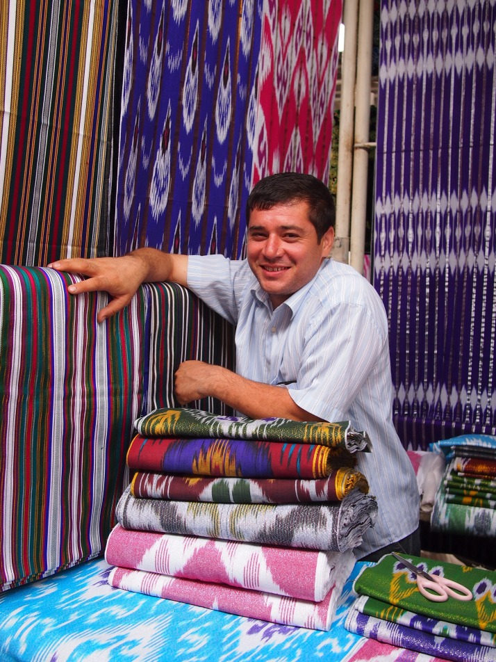 Silk vendor at Margilon Bazaar