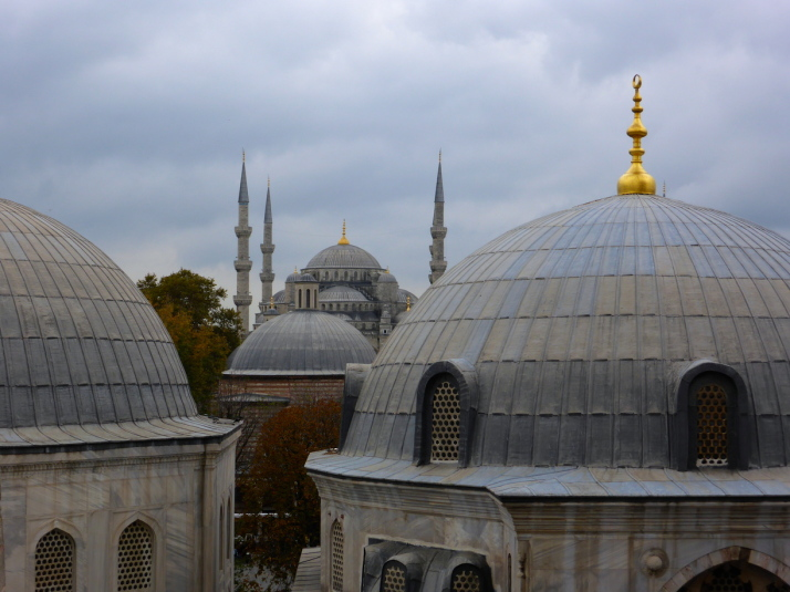 Sultan Ahmet Camii (The Blue Mosque) in the background, past the domes of 3 of the Turbes in the grounds of Haghia Sophia