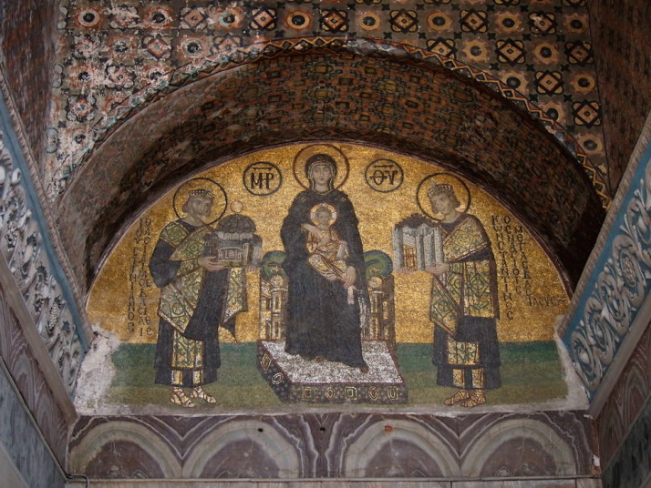 Mosaic of the Mother of God holding the Christ Child and flanked by Constantine the Great on the left offering a model of Constantinople, and Justinian on the right offering a model Haghia Sophia
