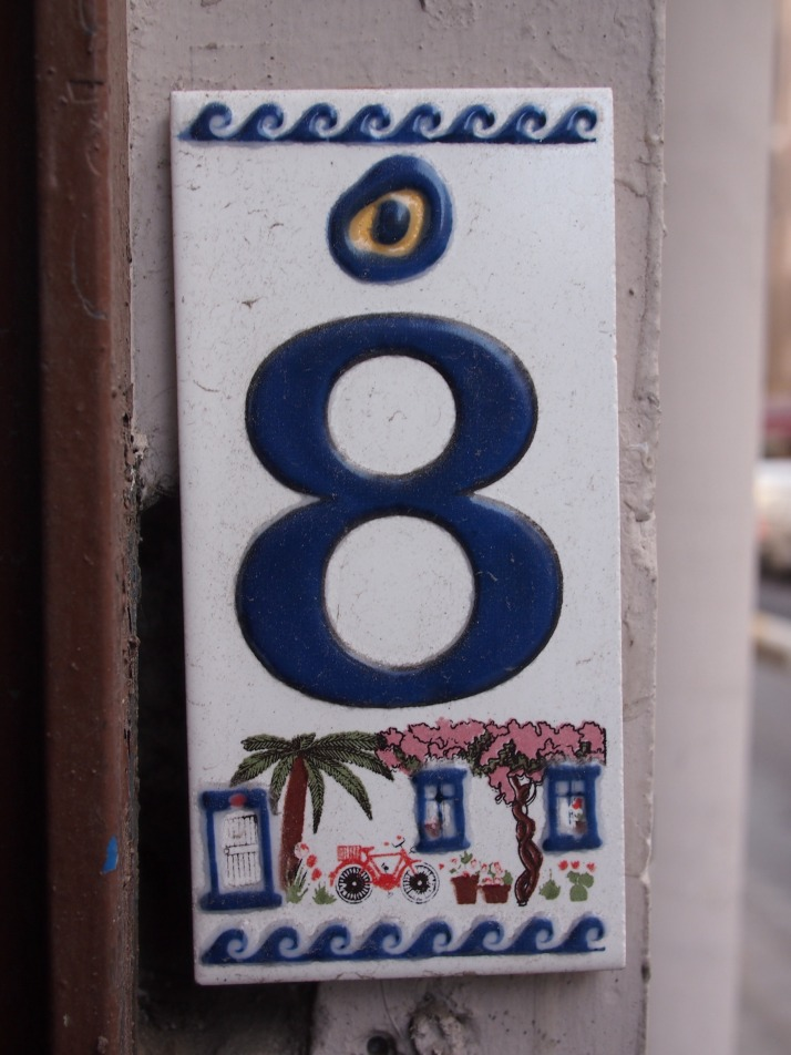 Evil eye on house number plate