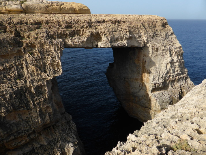 The naturally formed window at the end of Wied il-Mielah, just a little further west along the northern coastline of Gozo
