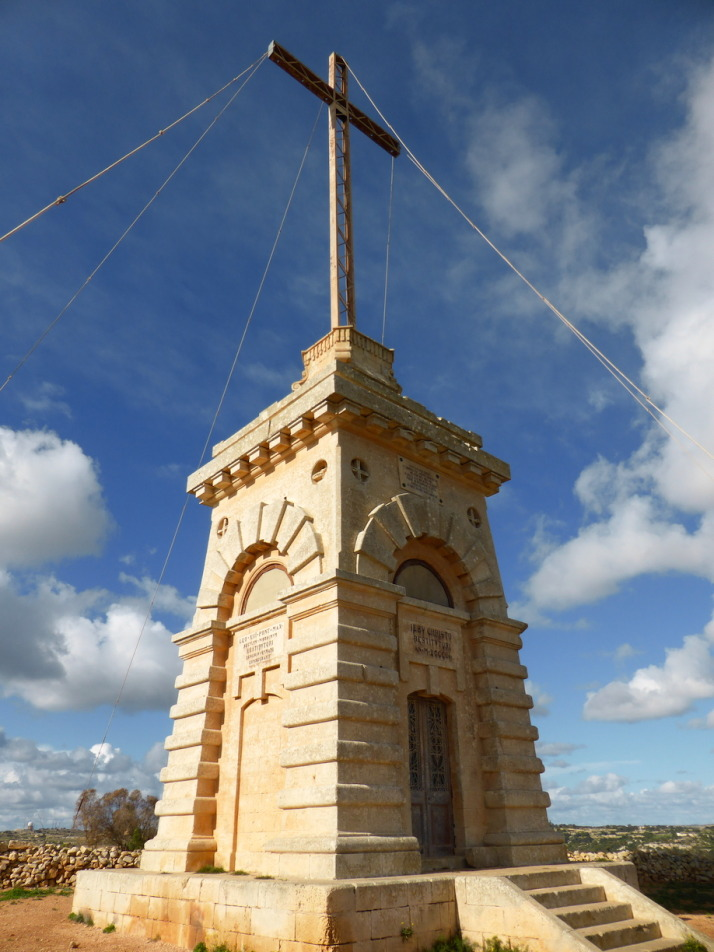 The huge bronze Laferla Cross next to the Assumption Church sits on the edge of the hill with lovely views over the second half of the walk