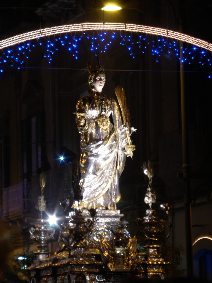 The lifesize silver statue of Santa Lucia in the parade, Siracusa, Sicily