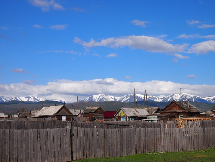 Snowy mountains above Baikalskoe