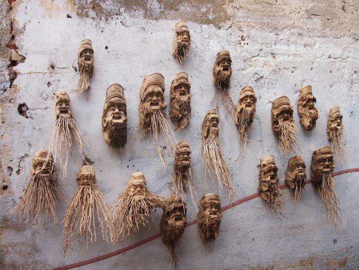Wooden masks on a wall in Hoi An, Vietnam