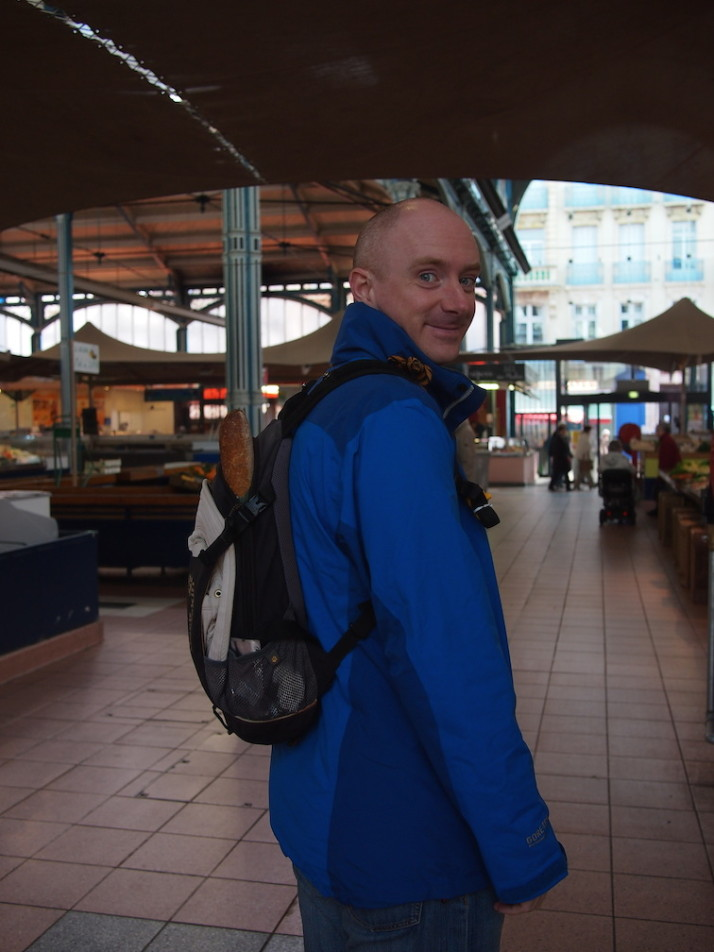 Andrew with a baguette in Dijon, France