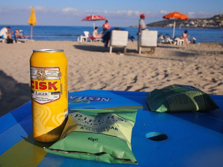 Beer and crisps on the beach