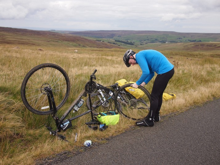 Andrew's impromptu bike workshop on the side of the road.  As we'd brought spare inner tubes we just swapped it out rather than finding and patching the hole