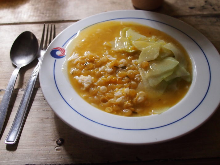 Bowl of plain rice, bean soup and chayote - a vegetable that tastes like a cucumber