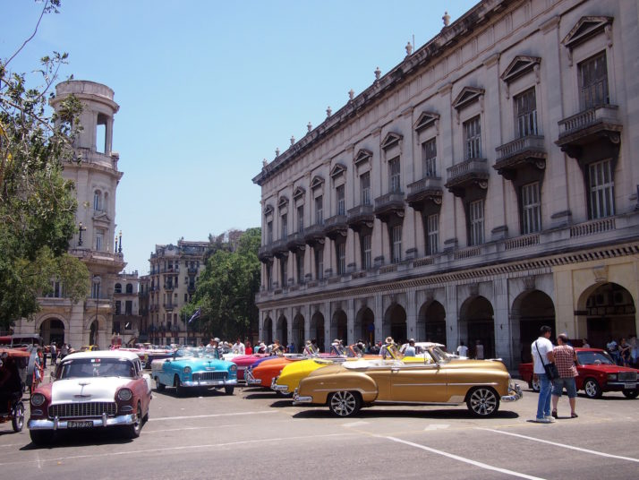 Line of classic cars in San Martin, Havana