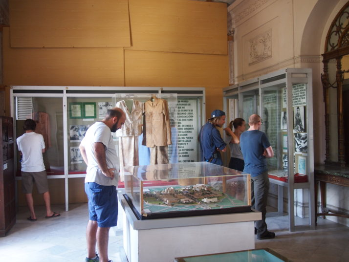 View of one of the exhibition rooms inside the Revolution Museum. Glass display cases line the walls