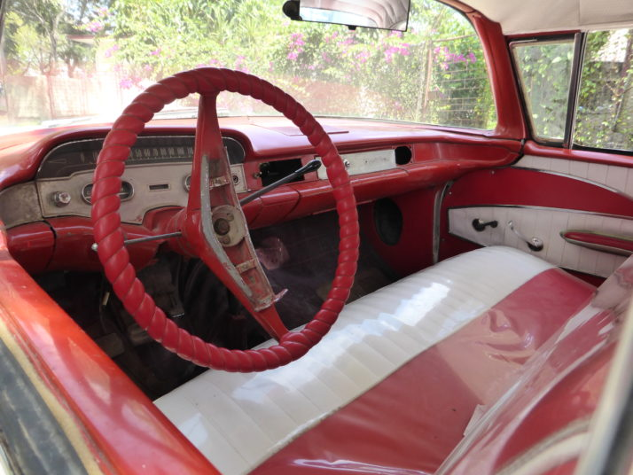 Bright red and white interior of the white 1958 Chevrolet Bel Air Coupe