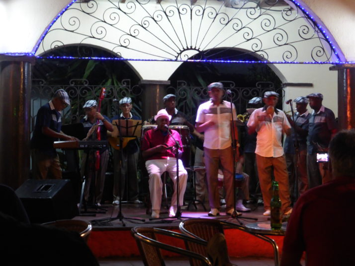 Full Cuban band performing on stage in the Casa de la Trova in Camagüey