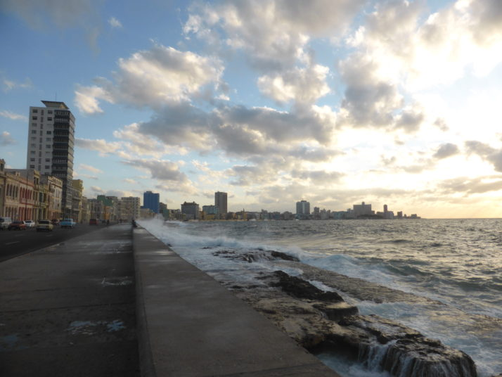 Havana's Malecón seaside promenade with waves crashing over the sea wall