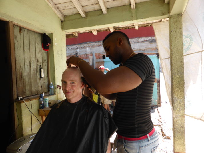 Andrew having his hair cut in Trinidad