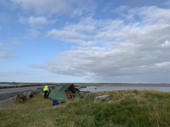 Tent pitched by the side of a causeway