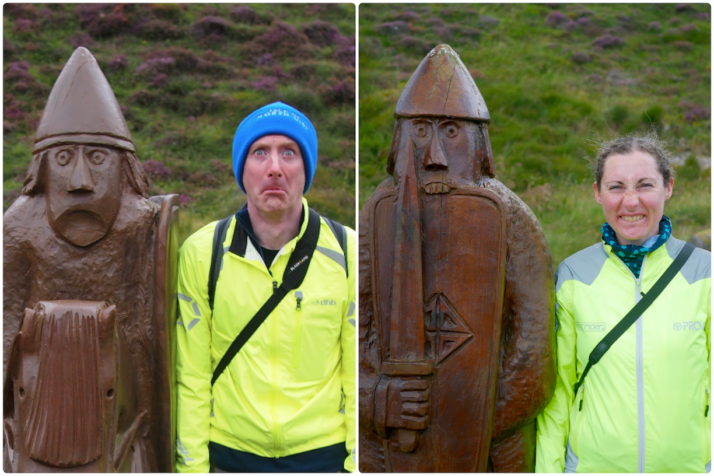 Andrew and Julie pulling silly faces in the style of the 2 Uig Chessmen carved statues