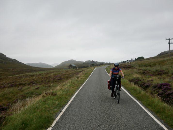 Cycling on the road near Loch Roag Beag